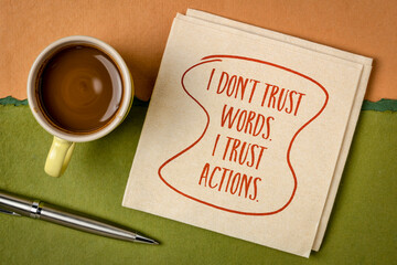 I do not trust words. I trust actions. Inspirational handwriting on a napkin with a cup of coffee....