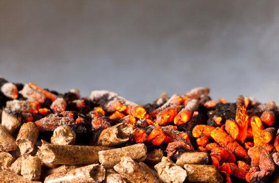 Close-up Of Burning Wood Pellets