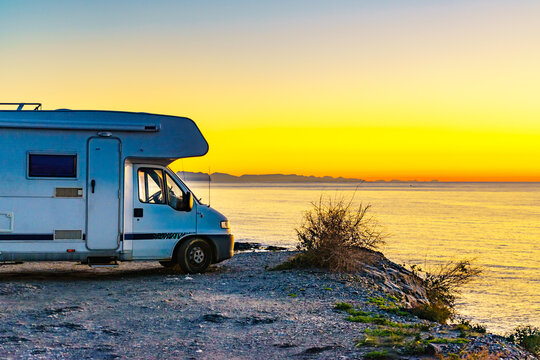 Rv camper camping on sea shore, Spain.