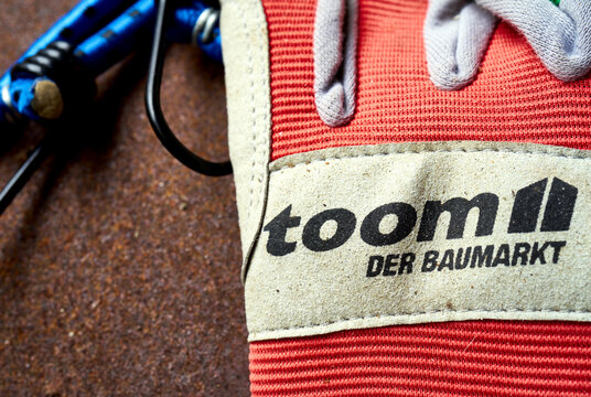 Toom DIY store gloves with the trademark and logo of the DIY chain, close-up of used work gloves in Gifhorn, Germany, November 17, 2020