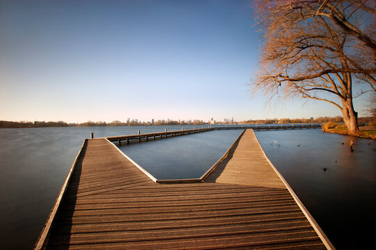 Jetty in the Kralingse Plas with the skyline of Rotterdam in the background in autumn