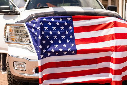 US flag on car trunk