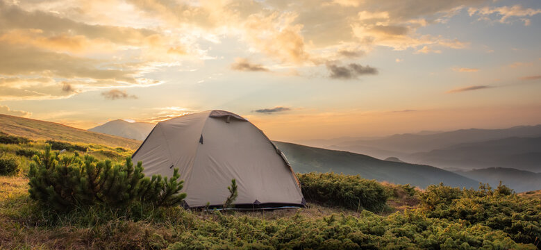 Camping tent in morning sun ray. Active lifestyle. Tatra mountains Zakopane, Poland