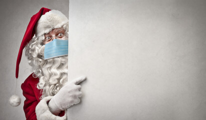 Printed kitchen splashbacks Akt Santa Claus with mask points on a white billboard