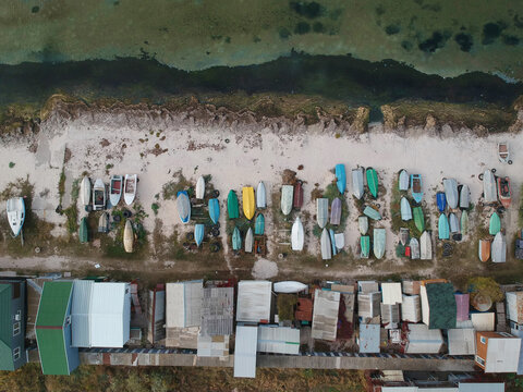 Aerial of a traditional fisher boats on a sand beach. Ukraine, Azov sea
