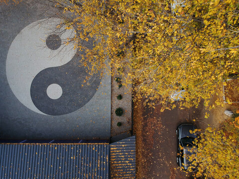 aerial photo of a yin yang sign in the park in autumn
