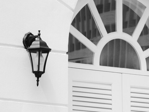 vintage lamp on exterior white wall at Thailand