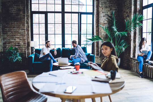 Diverse colleagues spending time in loft office