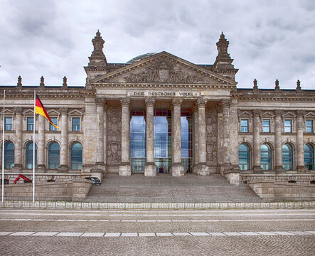 Berlin, Germany - Reichstag, parliament facade with the German flag