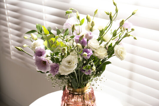 Bouquet of beautiful Eustoma flowers in room, closeup