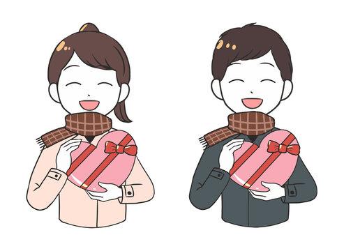 笑顔でバレンタインチョコを贈る 屋外