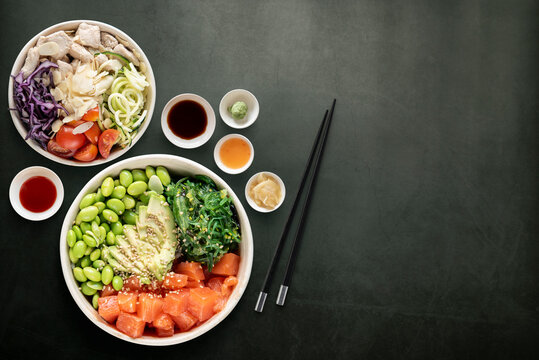 Top view of poke bowls composition with various sauces
