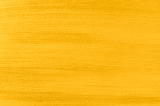 Acrylic gold paint abstract texture or painting for your banner or poster. Banner toned in trendy 2021 color