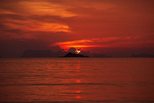 Beautiful red colorful sunset or sunrise over sea landscape.