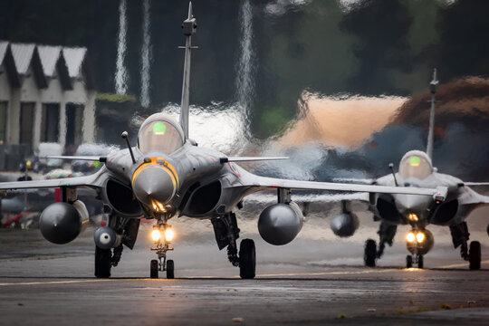 French Air Force Dassault Rafale fighter jets taxiing to the runway at Mont-de-Marsan Airbase.