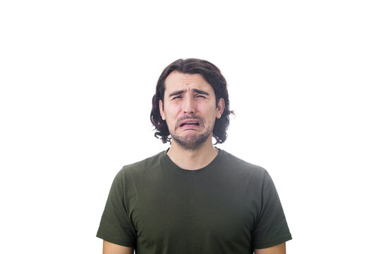 Portrait of desperate young man crying isolated on white background. Dissatisfied and disappointed guy sobbing and weeping to camera.