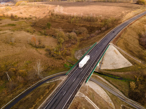 Aerial Top View of White Truck with Cargo Semi Trailer Moving on