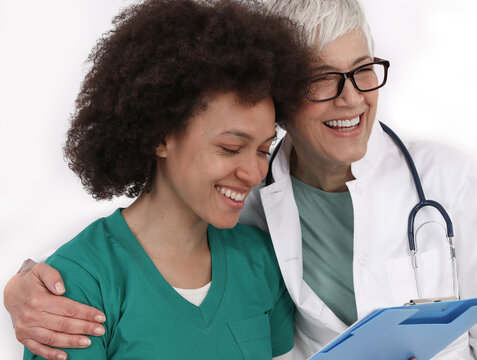 Happy laughing doctor and nurse . Diversity concept. Mentor support