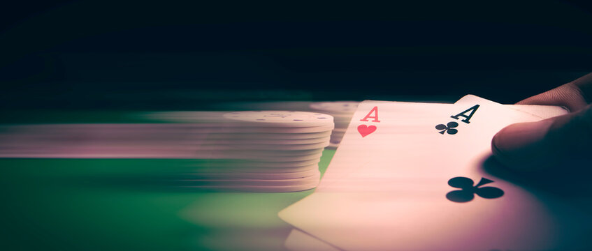 Gambling .Close-up cards for playing poker on a gaming table in a casino