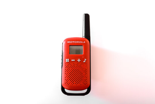 Valencia, Spain - November 18, 2020: Red walkie talkie of the American company Motorola, isolated on white.