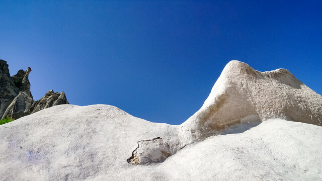 Low Angle View Of Chalky Mountains Against Clear Blue Sky