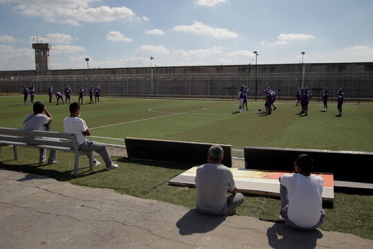 Inmates watch the training of the prison football team at the Apodaca prison in the municipality of Apodaca