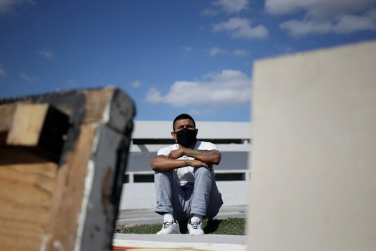 An inmate watches the training of the prison football team at the Apodaca prison in the municipality of Apodaca