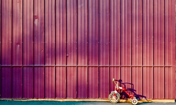 Tricycle Parked On Road By Wall