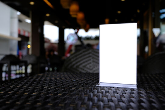 Close-up Of Blank Placard On Table In Restaurant