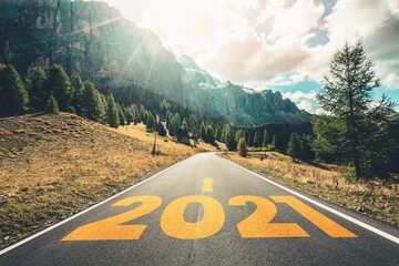 2021 New Year road trip travel and future vision concept . Nature landscape with highway road...