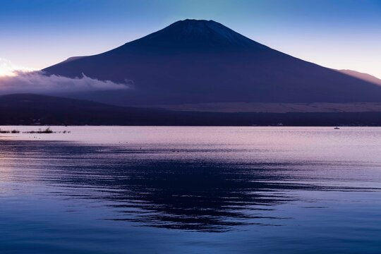 Calm atmosphere in the evening, Mount Fuji and Lake Yamanaka after sunset in autumn color