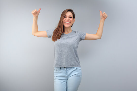 Happy emotional woman wearing gray t shirt with copy space.