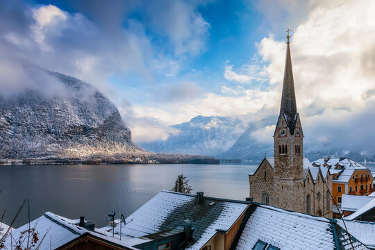 View over the roofs of the little village of Hallstatt, Austria, to the Hallstätter Lake and snow covered mountains of the Alps during winter time