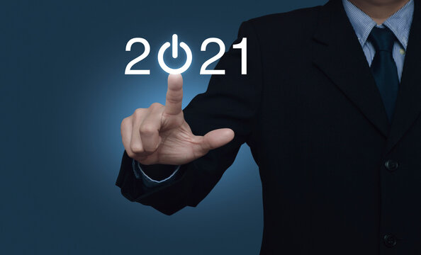 Businessman pressing 2021 start up business flat icon over gradient light blue background, Business happy new year cover concept