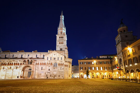 Modena, night view of Piazza Grande, Modena city, Duomo and Ghirlandina tower, Unesco world heritage site