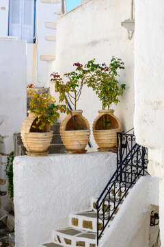 Street decorated with pots in Lefkes village on Paros Island, Cyclades, Greece