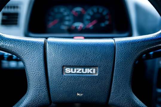 Miercurea Ciuc, Romania- 21 November 2020: Steering wheel on old Suzuki Vitara, visible dashboard on the blurred background.