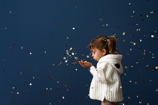 Cute Toddler Girl Playing with Confetti