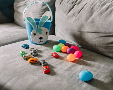 Toy cars and plastic Easter eggs