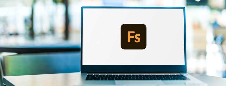 Laptop computer displaying logo of Adobe Fuse