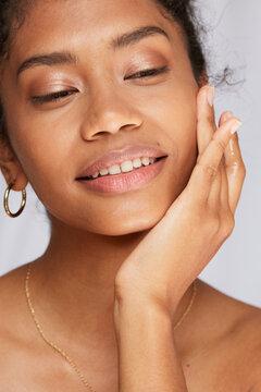 Woman applying moisturizing lotion