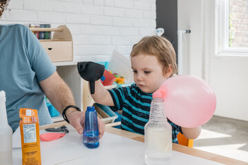 Toddler doing science experiment