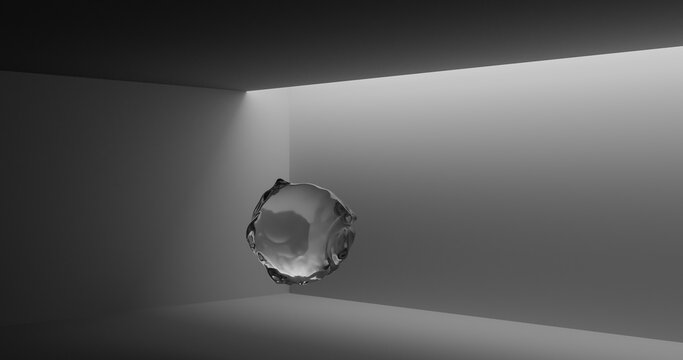Minimal space with natural light entering where there is a drop of water floating