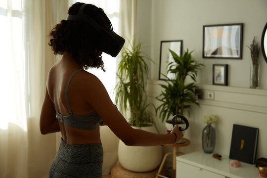 Unrecognisable woman Exercising in VR