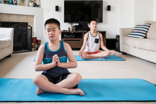 Asian Kids Doing Yoga at Home
