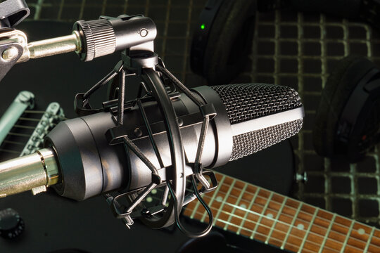 Condenser microphone on a guitar background