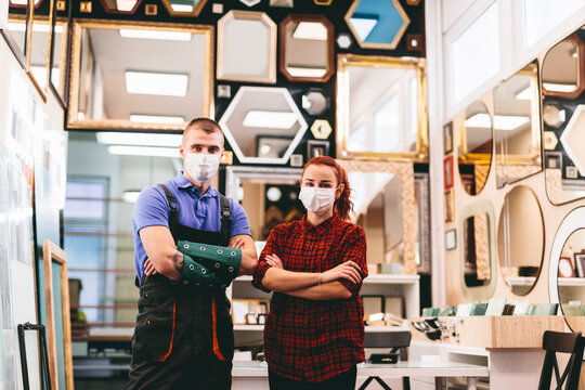 Small business owners with face masks during coronavirus Covid-19,