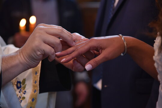 Cropped Image Of Bridegroom Inserting Wedding Ring In Bride Finger