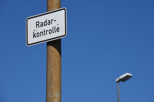 Wolfsburg, Lower Saxony / Germany - April 6, 2020: German road sign warning of speed measurements in Wolfsburg, Germany - Radarkontrolle