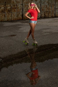 Beautiful young woman with roller skates - roller skating